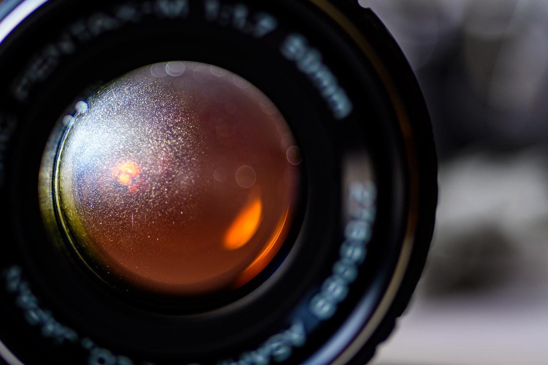 Dust shown inside Pentax 50mm 1.7 SMC lens.