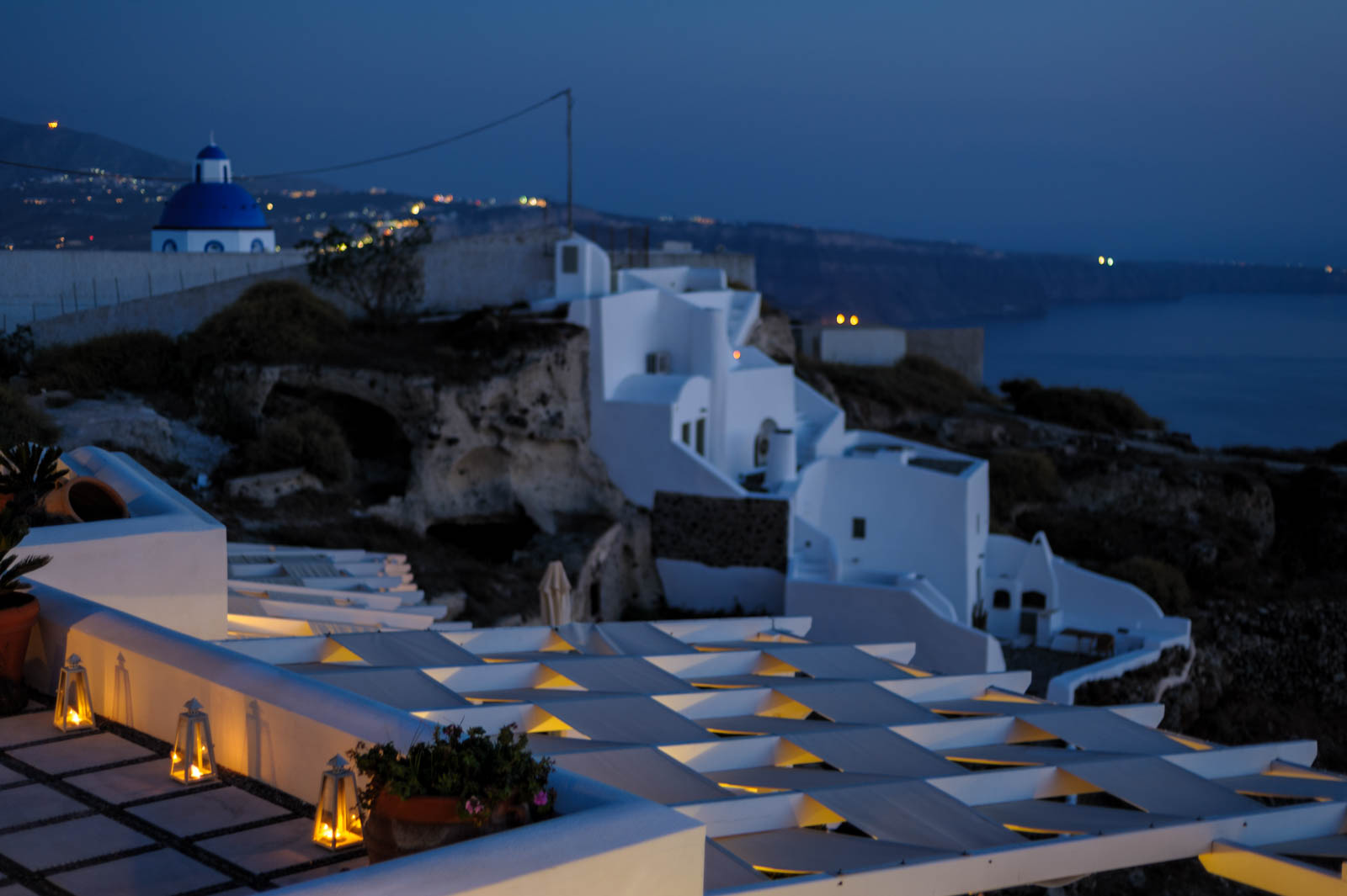 Blue hour light over Imerovigli and Fira,. Pegasus suites in front.