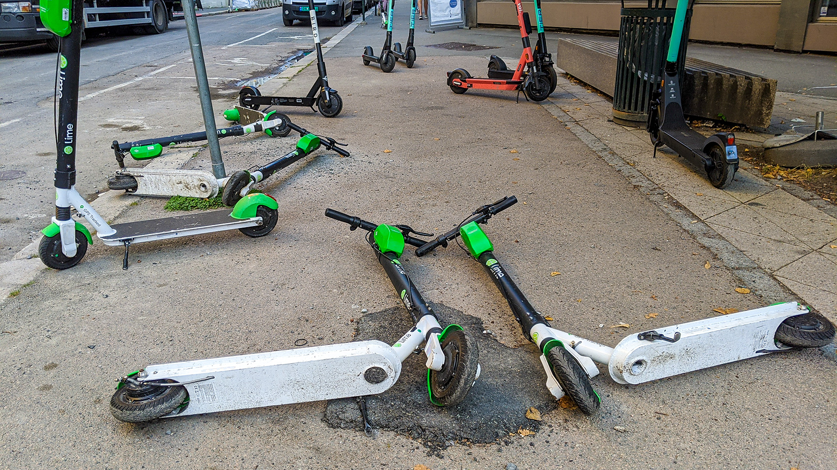 E-scooters are blocking a sidewalk in Oslo, Norway.