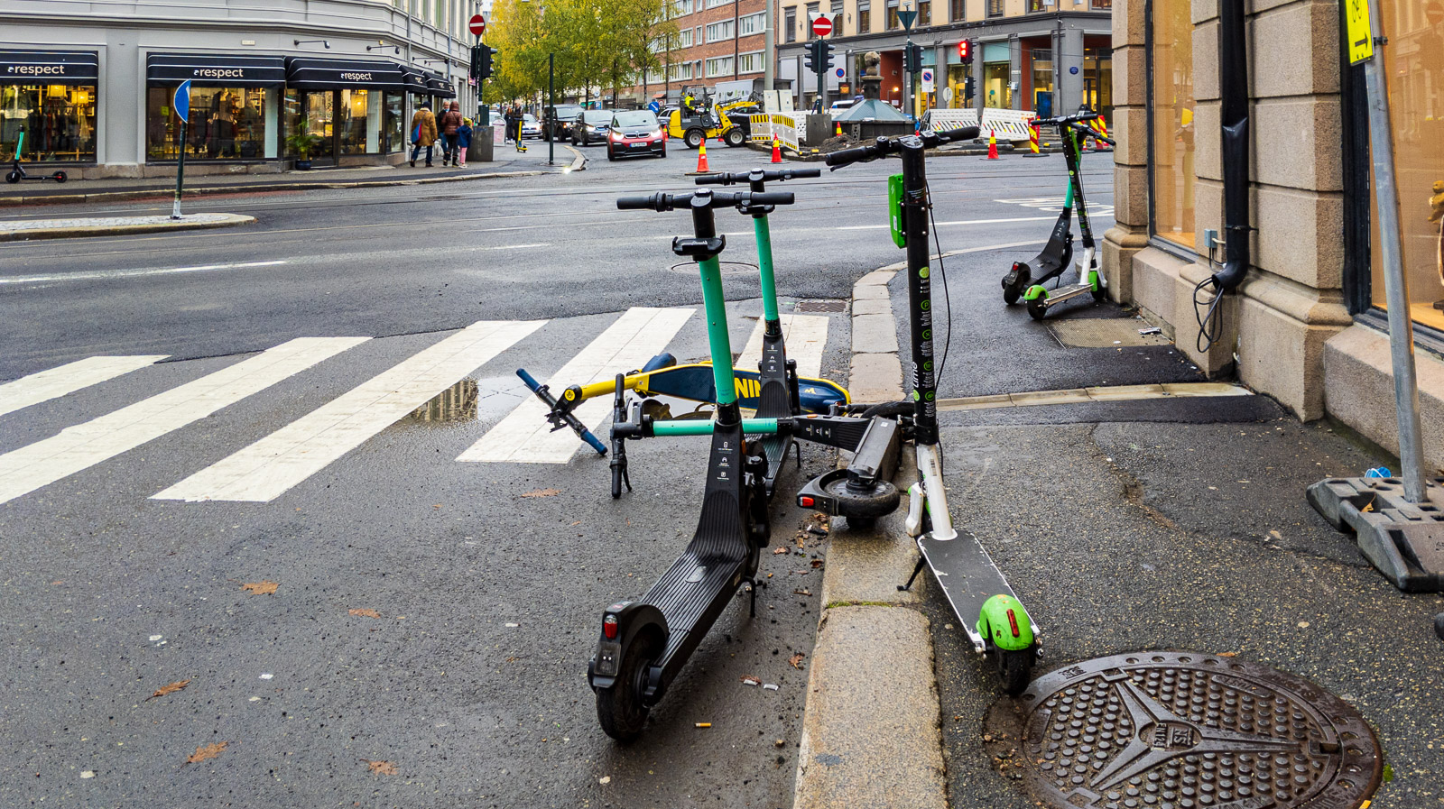 E scooters on sidewalk and pedestrian crossing, Oslo.