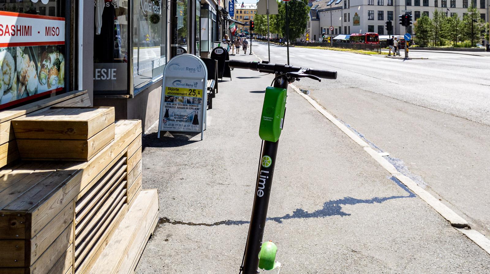 Lime e-scooter blocks sidewalk in Oslo